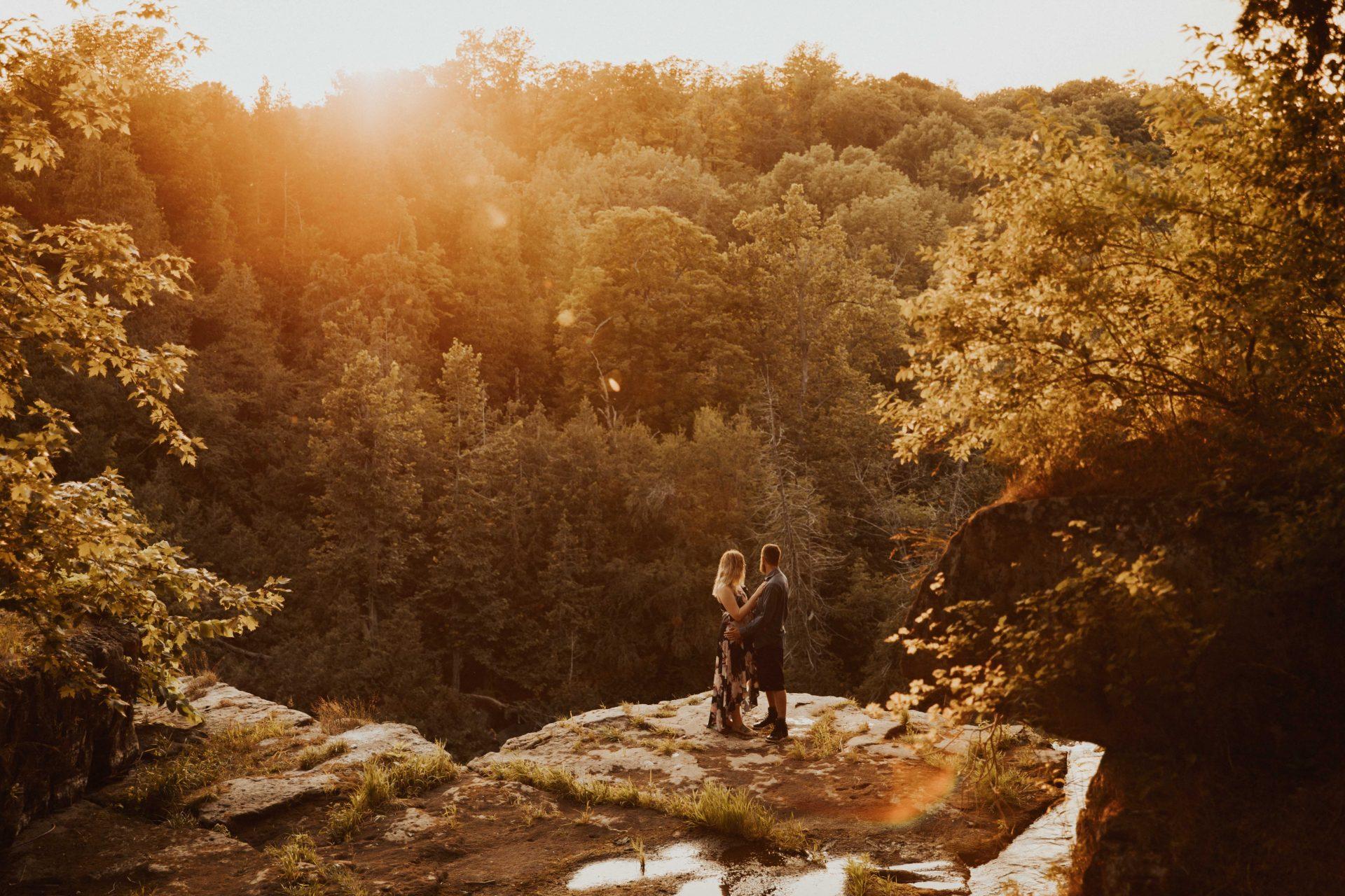 waterfall engagement photos at sunset