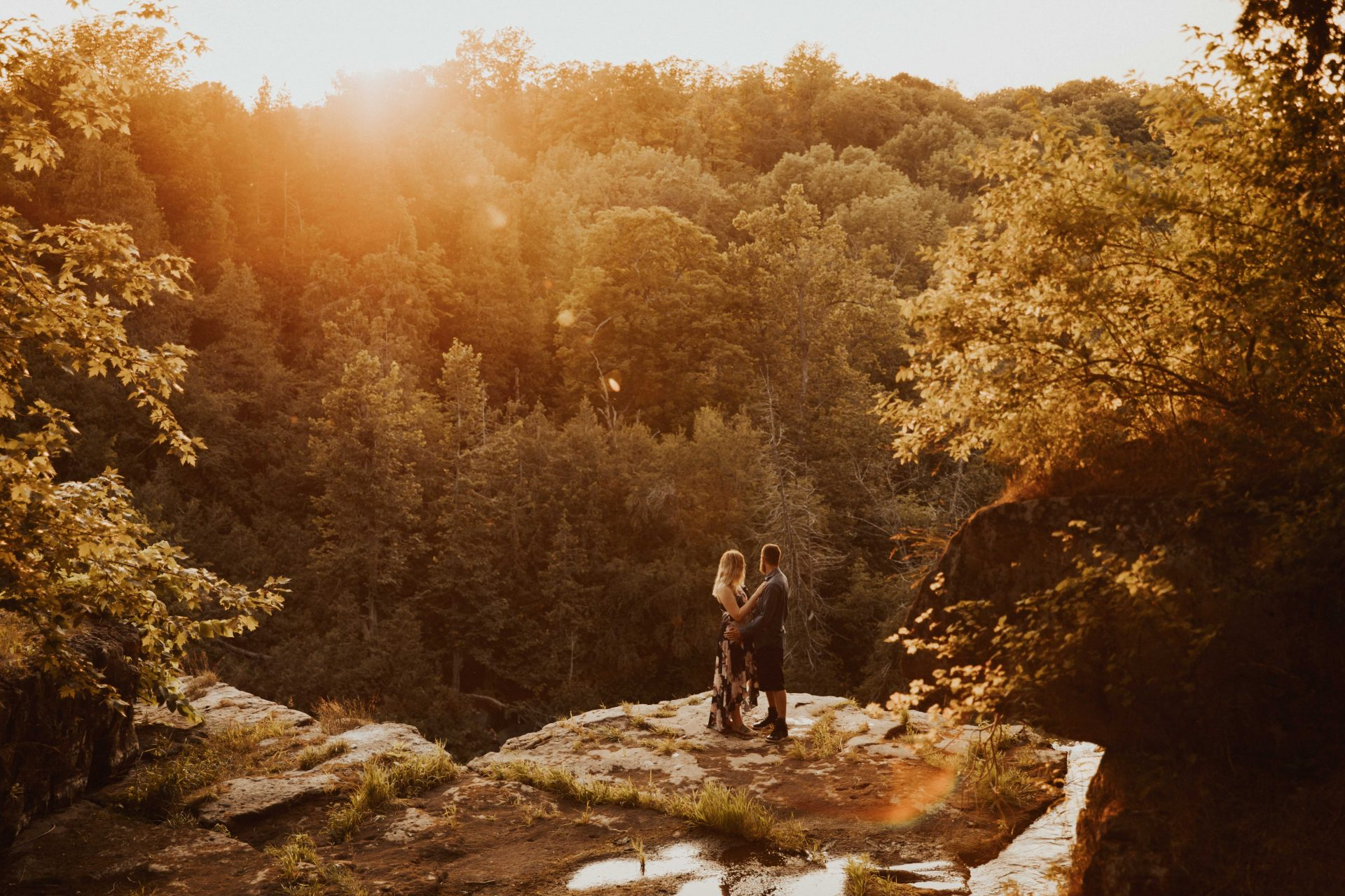 waterfall engagement photos at sunset