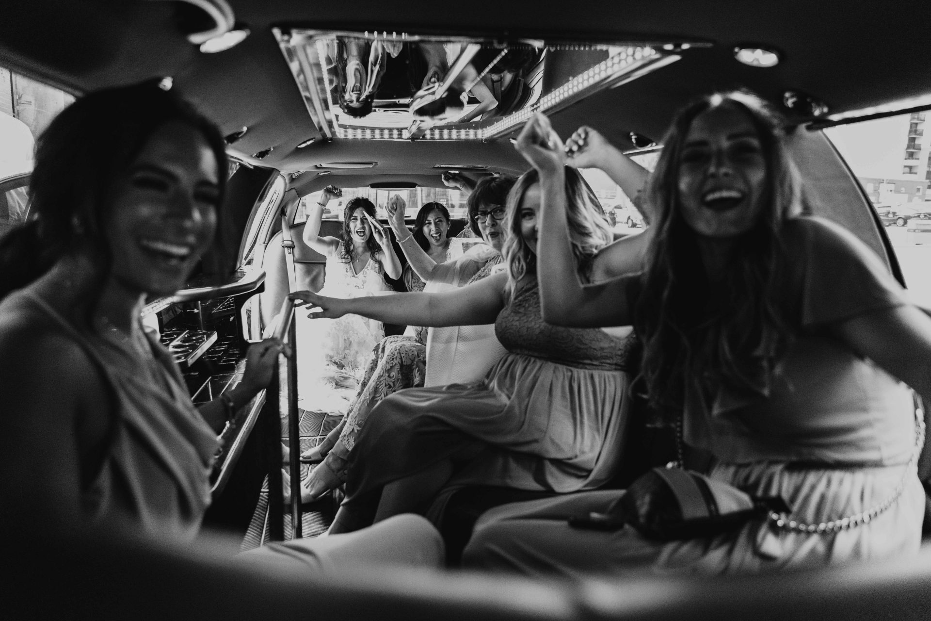 bride and bridesmaids in limo
