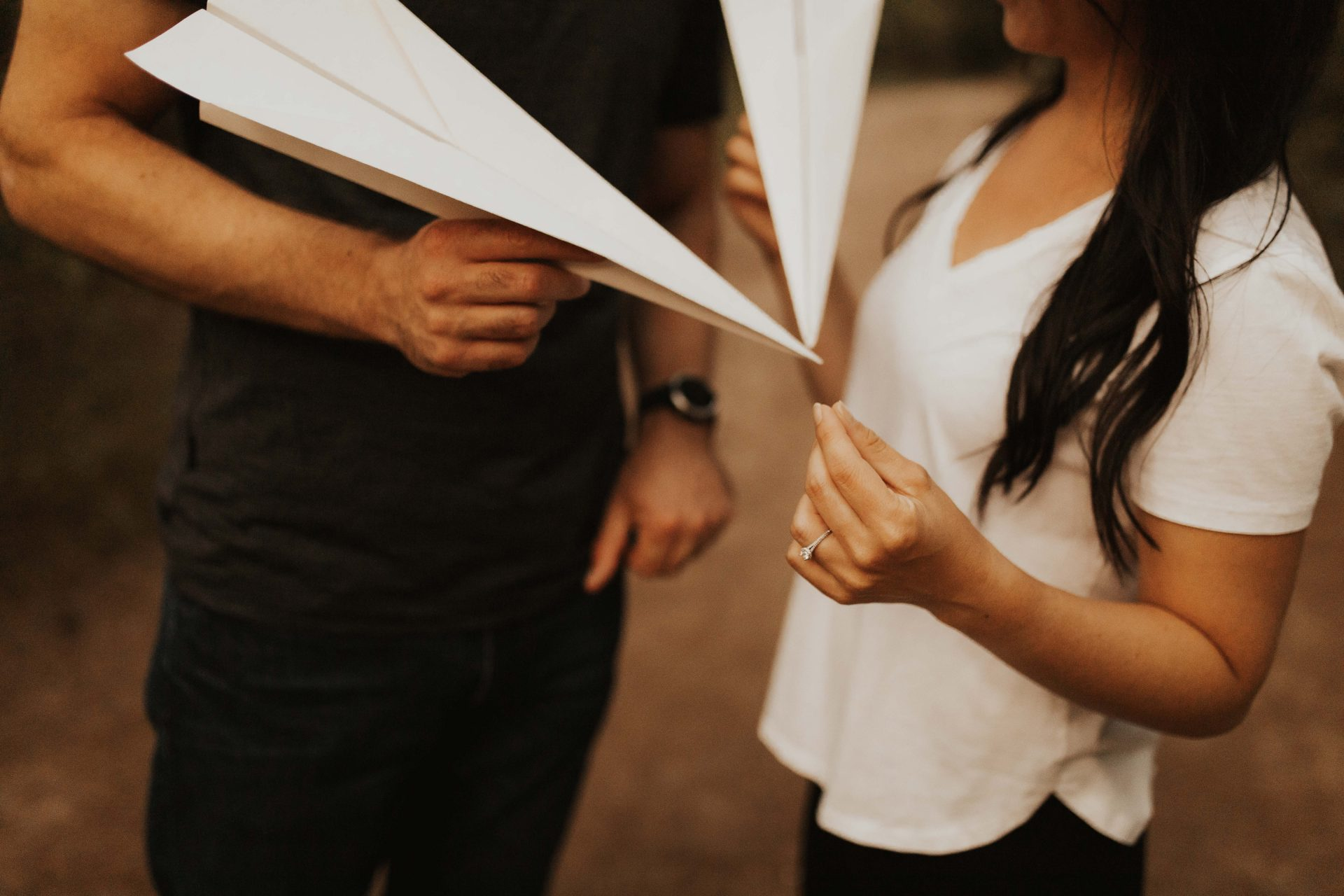 engagement photos with paper airplanes