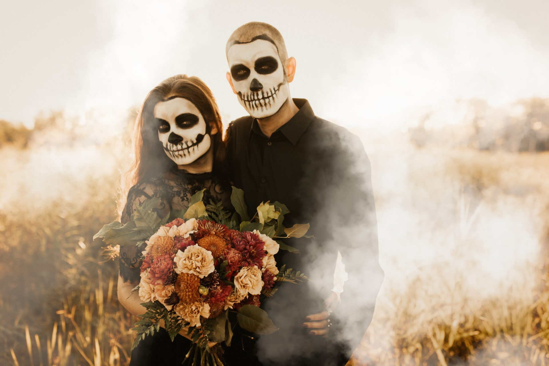 halloween couples shoot with skeleton faces