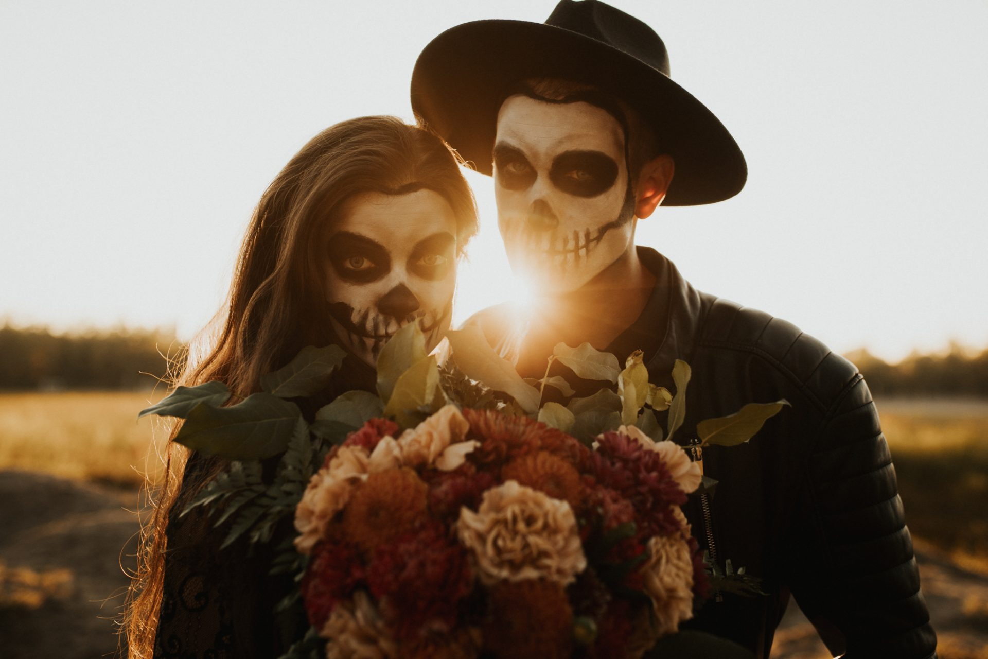 halloween styled couples shoot with skeleton makeup