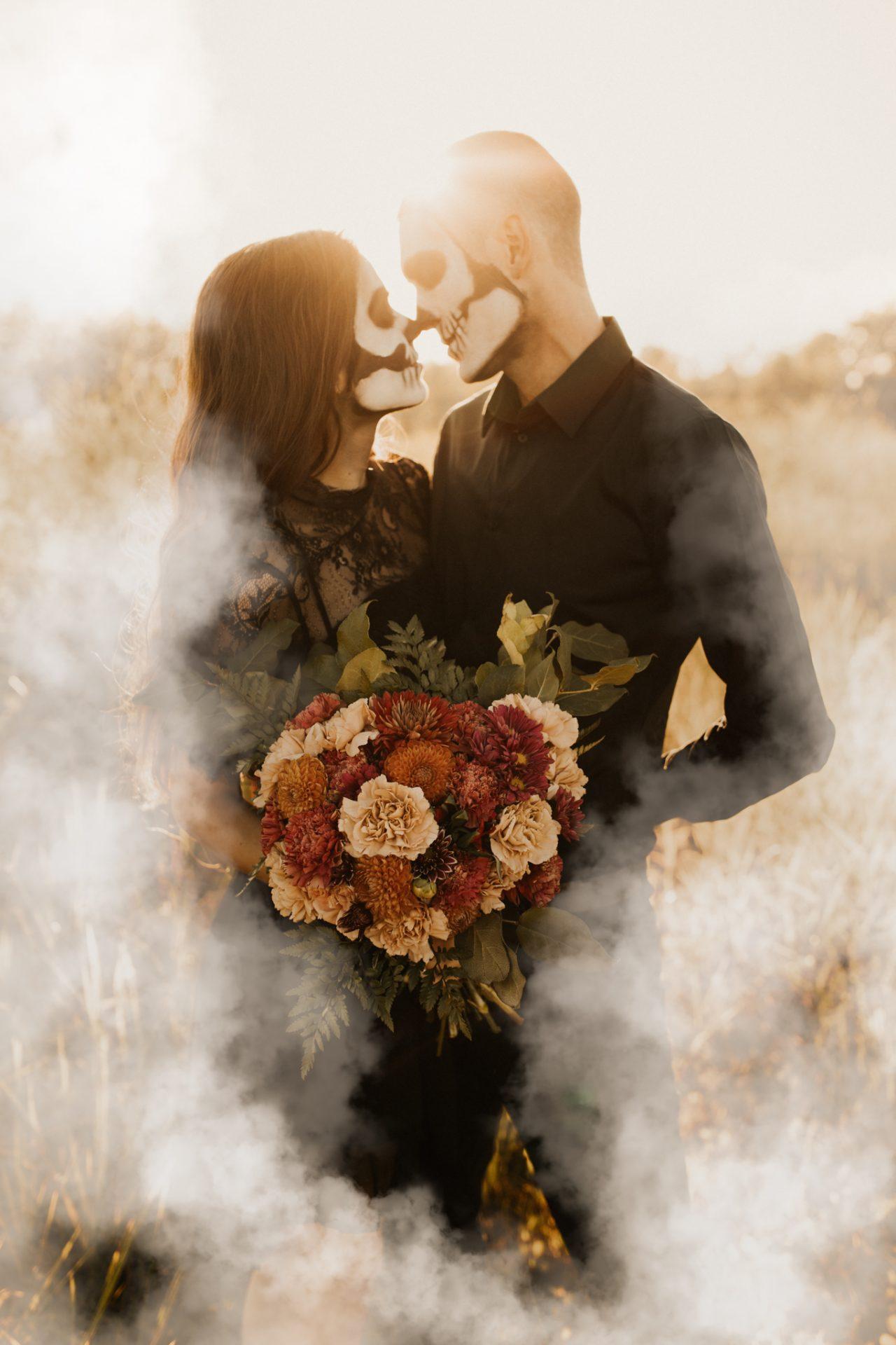 halloween couples shoot with smoke bombs