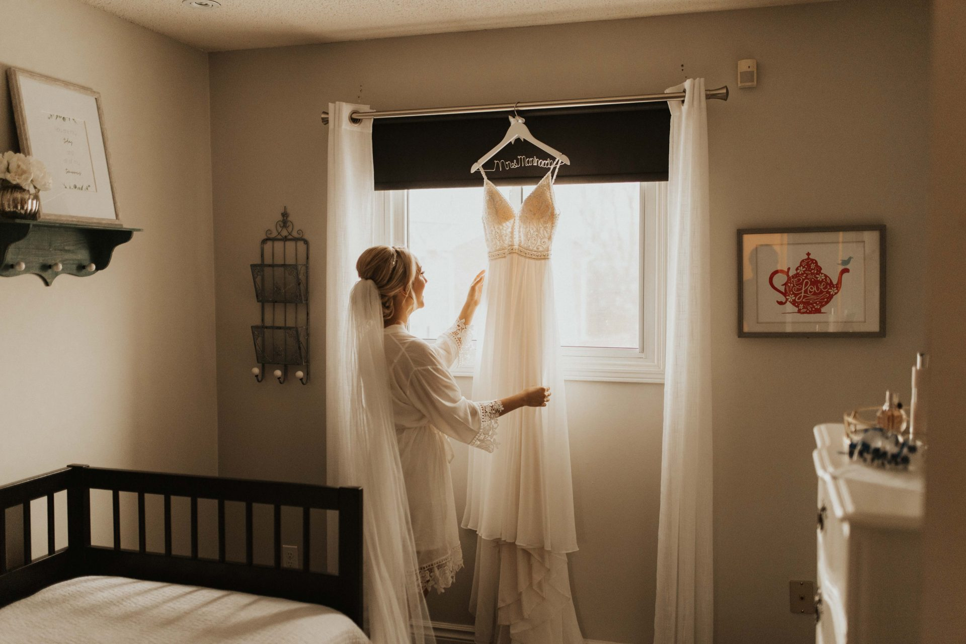 bride reaching for wedding dress