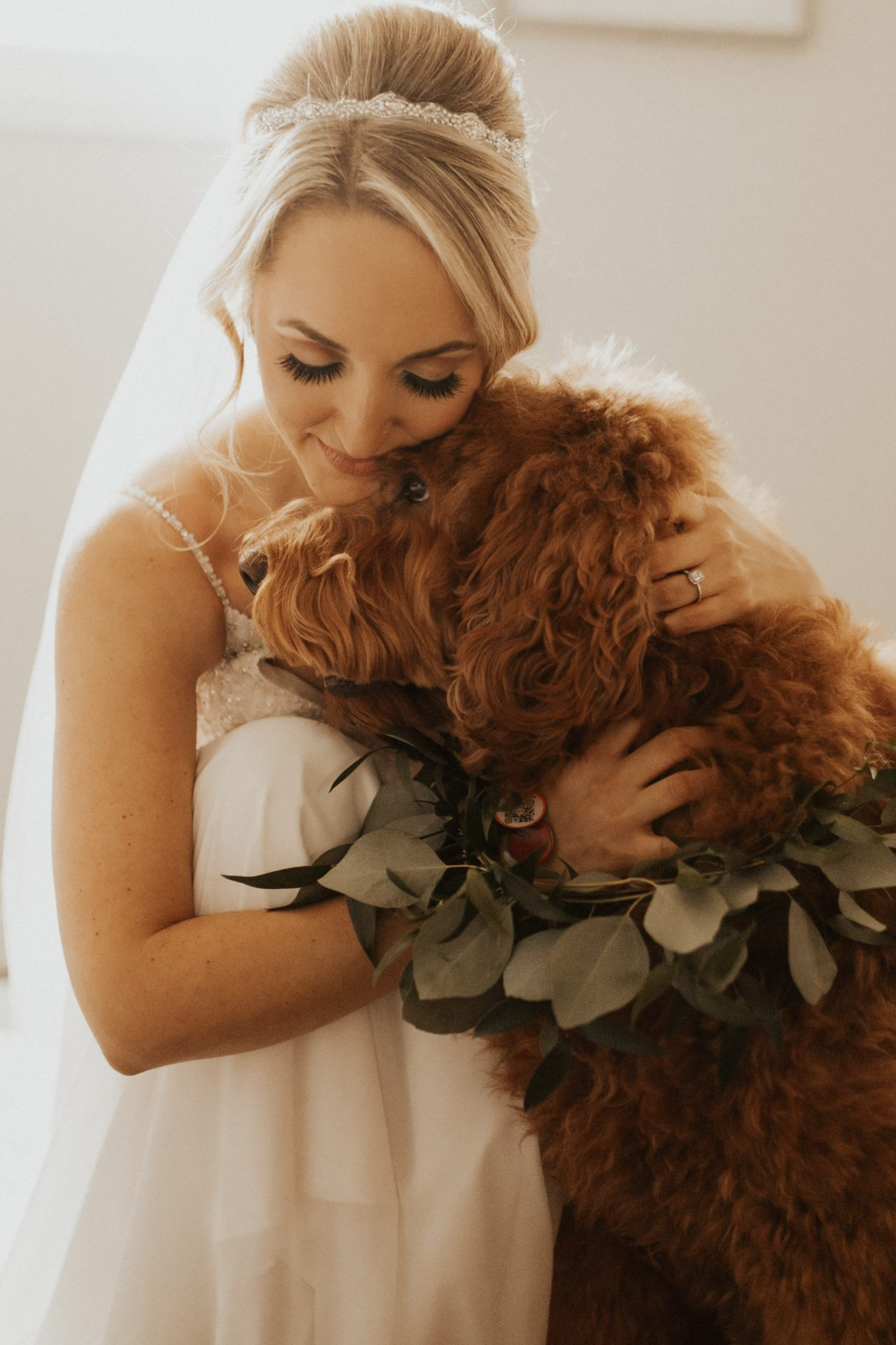 bride hugging her dog
